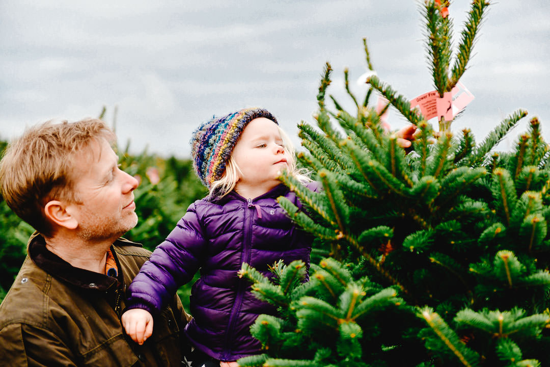 Father and daughter picking their own Christmas tree